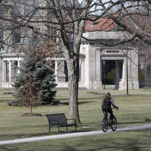 A student riding a bicycle on the campus of Oberlin College in Oberlin, Ohio.