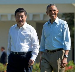 FILE - In this June 8, 2013, file photo, President Barack Obama and Chinese President Xi Jinping, left, walk at the Annenberg Retreat of the Sunnylands estate in Rancho Mirage, Calif.  (AP Photo/Evan Vucci)