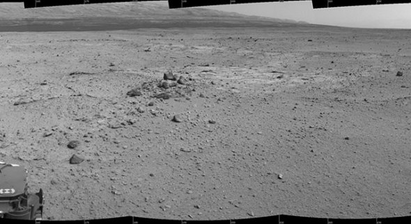 This mosaic of images from the Navigation Camera (Navcam) on NASA's Mars rover Curiosity shows the scene from the rover's position on the 376th Martian day, or sol, of the mission (Aug. 27, 2013). The images were taken right after Curiosity completed the first drive during which it used autonomous navigation on unknown ground. Credit: NASA/JPL-Caltech › Full image and caption