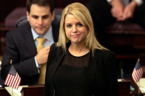 Florida Attorney General Pam Bondi visits the House to follow the progress of a mortgage settlement bill during a session of the legislature on April 30, 2013, in Tallahassee. (Steve Cannon/AP)