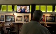 "John Merry watches President Barack Obama deliver a speech about relations with Syria from McP's Pub, Tuesday, Sept. 10, 2013,  in Coronado, Calif.  Obama said in a nationally televised address Tuesday night that recent diplomatic steps offer ""the potential to remove the threat of chemical weapons"" inside Syria without the use of force, but he also insisted the U.S. military will keep the pressure on President Bashar Assad ""and be ready to respond"" if other measures fail. (AP Photo/Gregory Bull)"