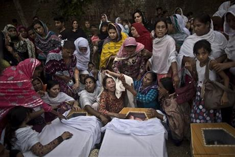 Sunday, Sept. 22, 2013: Peshawar, Pakistan_Pakistani women grieve over the coffins of their relatives, who were killed in a suicide attack on a church. The suicide bomb attack killed scores of people Sunday, in one of the worst assaults on the country's Christian minority in years. An assault by Islamic extremists at a Kenya mall, a suicide attack on a Pakistani church and assaults by suicide bombers targeting mourners at Shiite and Sunni funerals in Iraq have killed more than 250 people and injured at least 470 others since Saturday. (AP Photo/Muhammed Muheisen)