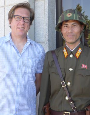 Special report: Ian Birrell (left) stands with a North Korean soldier (right) in Pyongyang