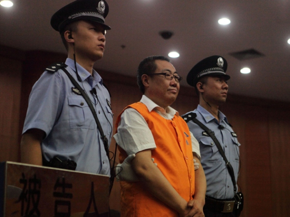 "Yang Dacai, centre, a Chinese official branded ""Brother Watch"" because of his expensive taste in timepieces, stands in the courtroom in the Intermediate people's court of Xian, northwest China's Shaanxi province on September 5, 2013. He was sentenced to 14 years in jail for corruption."