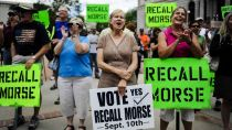 Janice Taylor, center, and other supporters of the recall election to oust Senate President John Morse rally outside the Pioneer Museum in Colorado Springs, Colo. Wednesday, Sept. 4, 2013.AP