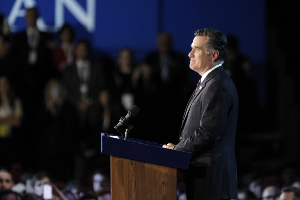 Romney pauses as he addresses supporters during his election night rally. Mary Altaffer / AP