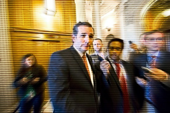Sen. Ted Cruz (R., Texas) leaves the floor of the Senate after a testy exchange with Senate Majority Leader Harry Reid (D., Nev.) at the start of legislative business, at the Capitol in Washington, Monday, Sept. 23, 2013.