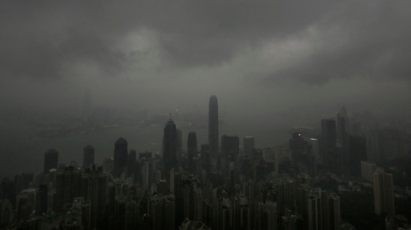 Sept. 22, 2013: Dark clouds hang low over Hong Kong's Victoria Habour. Usagi, the year's most powerful typhoon had Hong Kong in its cross-hair on Sunday after sweeping past the Philippines and Taiwan and pummeling island communities with heavy rains and fierce winds. The typhoon was grinding westward and expected to make landfall close to Hong Kong late Sunday or early Monday. (AP)