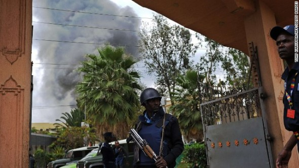 A Kenyan police officer guards the entrance of a building near the Westgate Shopping Mall in Nairobi, Kenya, on Monday, September 23. Gunmen burst into the mall and opened fire in a deadly attack on September 21. Kenyan authorities sounded increasingly confident Monday that they had brought the three-day standoff to a close, reassuring a nervous public that there was little chance of escape for any surviving Al-Shabaab gunmen who had terrorized the mall, killing dozens of people.