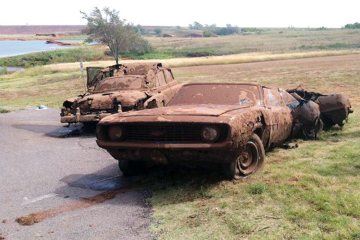 This Sept. 17, 2013, photo shows two cars recovered from Foss Lake, Okla. Laura Eastes / AP