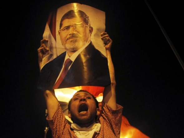 morsi_supporter_night_reuters