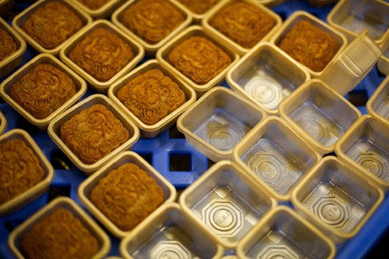 Finished mooncakes sit in individual trays at Caritas Hong Kong's La Vie Bakery food factory in Hong Kong on Sept. 7, 2012.