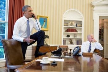 How stressed is Obama? He's starting to climb onto the Resolute desk during phone calls. To the right, Vice President Biden thinks about squirrels.