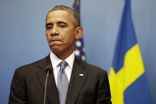 President Barack Obama pauses during a news conference with Swedish Prime Minister Fredrik Reinfeldt in Stockholm on September 4, 2013. (Pablo Martinez Monsivais/AP)