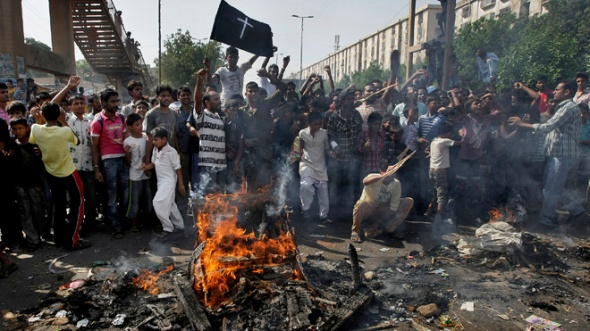 Sept. 22, 2013: Pakistani Christians chant slogans as they burn materials during a protest against a suicide attack on a church in Karachi, Pakistan. A suicide bomb attack on a historic church in northwestern Pakistan killed scores of people Sunday, officials said, in one of the worst assaults on the countrys Christian minority in years. (AP)
