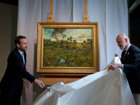 "Van Gogh Museum director Axel Rueger, left, and senior researcher Louis van Tilborgh, right, unveil ""Sunset at Montmajour"" during a press conference at the Van Gogh Museum in Amsterdam, Netherlands, Monday Sept. 9, 2013. The museum has identified the long-lost painting which was painted by the Dutch mater in 1888, the discovery is the first full size canvas that has been found since 1928 and will be on display from Sept. 24.AP Photo/Peter Dejong"
