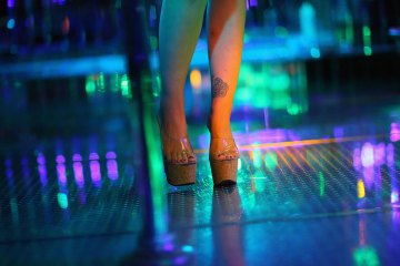 Joe Raedle / Getty Images A dancer at the '2001 Odyssey' strip club, one of TIME's 10 strangest strip clubs in America.