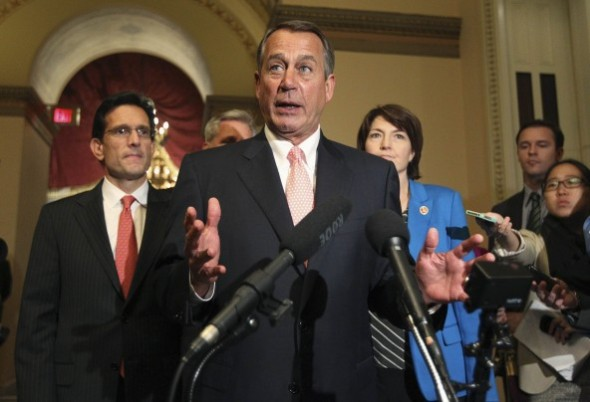 Jim Bourg/Reuters - House Speaker John Boehner speaks to the media at 1 a.m. after the House voted to send their funding bill with delays to Obamacare into a conference with the Senate, prompting a shutdown of portions of the U.S. government.
