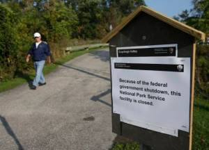 John Carano, 65, walks on a trail at the Cuyahoga Valley National Park Tuesday, Oct. 1, 2013, in Valley View, Ohio. The impacts of the federal shutdown began rippling across Ohio on Tuesday morning, with a national military museum and national park closing and thousands of federal employees going on furlough. (AP Photo/Tony Dejak)