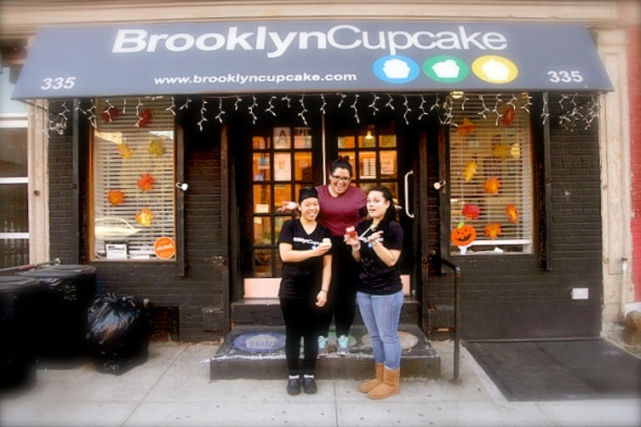 "October 29, 2013: Brooklyn, NY - From left, Candy Chao, 31, Crystal Rodriguez, 23, and Christine Nelson, 22, pastry chefs, pose for a photograph at Brooklyn Cupcake on Union Ave. Brooklyn Cupcakes has been mistakenly put on a list for Affordable Care Act registration. Nelson said ""We probably get 1-2 calls a day. It's kind of funny since we sell cupcakes."""