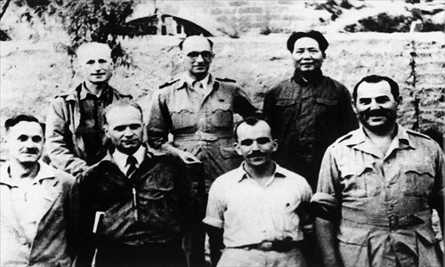 A photograph taken in 1944 showing Mao Zedong (first from right in the second row) with foreign correspondents in Yan'an Photo: Courtesy of Shanghai Municipal Archives Bureau