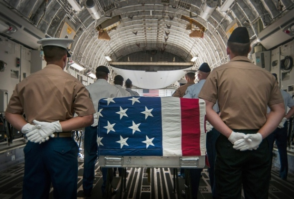 An honor detail comprised of joint military members prepares to escort the remains of fallen servicemembers who died during World War II and the Vietnam War during an arrival ceremony April 26, 2013, hosted by the U.S. Joint POW/MIA Accounting Command.  SEAN FUREYU.S. NAVY