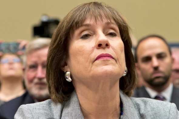 FILE - In this May 22, 2013 file photo, Lois Lerner, head of the IRS unit that decides whether to grant tax-exempt status to groups, listens on Capitol Hill in Washington. Lerner, the official at the center of the agency's tea party scandal is retiring. Lerner headed the IRS division that handles applications for tax-exempt status when she was placed on paid leave in May. While she was in charge, the agency acknowledged that agents improperly targeted tea party groups for extra scrutiny when they applied for tax-exempt status from 2010 to 2012. (AP Photo/J. Scott Applewhite, File)