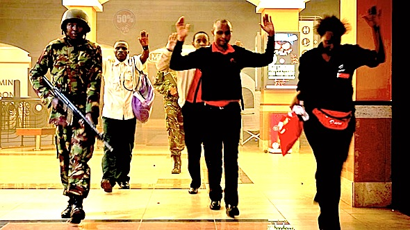 Kenya Civilians who had been hiding during a gun battle hold their hands in the air as a precautionary measure before being searched by armed police leading them to safety, inside the Westgate Mall, Sept. 21, 2013. Jonathan Kalan/AP Photo