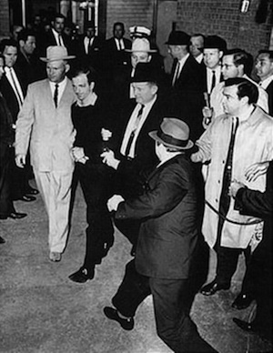Lee_Harvey_Oswald_being_shot_by_Jack_Ruby_as_Oswald_is_being_moved_by_police_1963