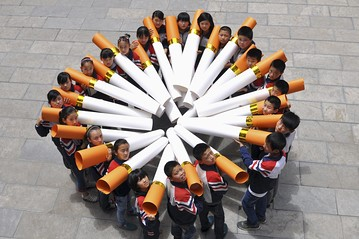 Students posed with cigarette models made from waste paper during a campaign ahead of the World No Tobacco Day in Handan, Hebei province, in May.