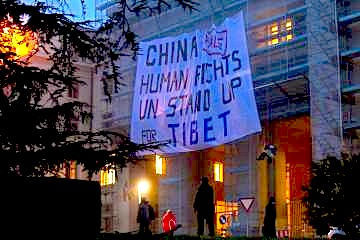 Members of the Students for a Free Tibet organization display a banner on scaffolding in front of the European headquarters of the U.N. in Geneva on Oct. 22, 2013 Denis Balibouse / Reuters