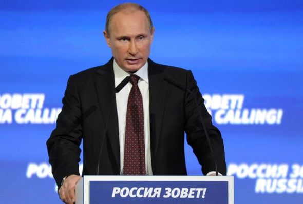 "Photo by: Alexei Nikolsky Russian President Vladimir Putin speaks at the Russia Calling investment forum in Moscow on Wednesday, Oct. 2, 2013. The sign reads, ""Russia Calling!"" (AP Photo/RIA-Novosti, Alexei Nikolsky, Presidential Press Service)"