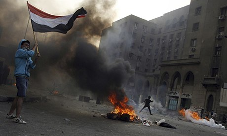 Tires burn as Egyptian Muslim brotherhood and supporters of ousted president Mohamed Morsi clash with riot police in Cairo on 6 October. Photograph: Mohammed Abdel Moneim/AFP/Getty Images