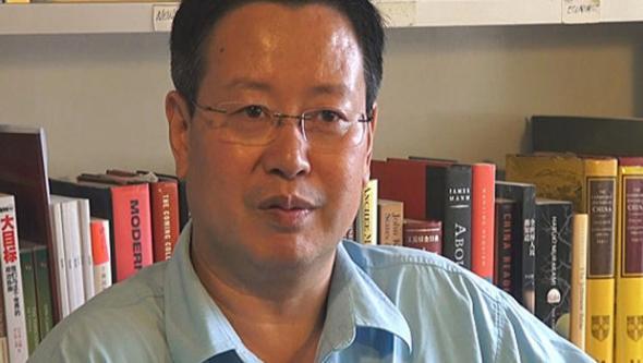 Peking University economics professor Xia Yeliang speaks to CBSNews.com at his office in Beijing, China.