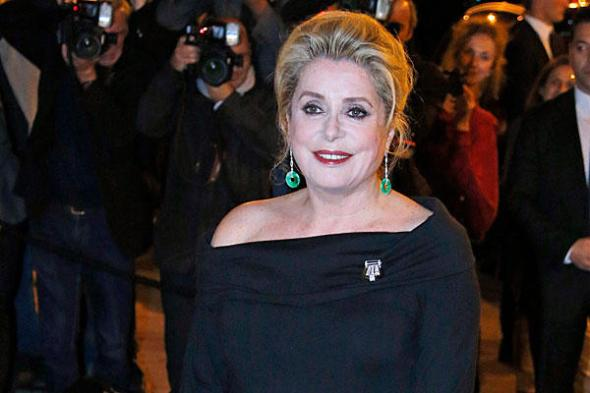 French actress Catherine Deneuve was among 70 French celebrities who signed a petition against cracking down on the clients of prostitutes. Here, Deneuve arrives at a Ralph Lauren Collection Show and private dinner in Paris, France, Oct. 8, 2013. (AP Photo/Francois Mori)