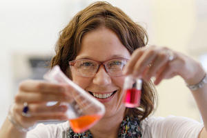 William & Mary professor Elizabeth Harbron displays vials with merocyanine and rhodamine dye in her lab in Williamsburg, Va. Steve Helber/AP
