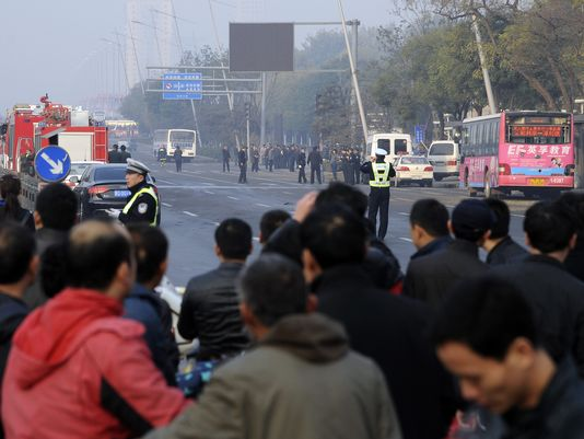 People gather near the site of multiple explosions outside the provincial headquarters of China's ruling Communist Party in Taiyuan. (Photo: AP)