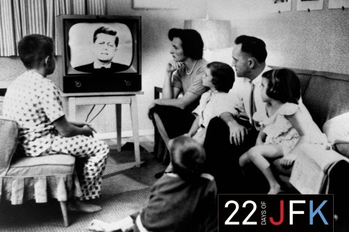 An American family gathers around a TV, which displays John F. Kennedy's face, to watch the debate between Kennedy & Richard Nixon during the presidential election. (Time Life Pictures/Getty)