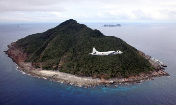A Japanese patrol plane, pictured in 2011, flying over the disputed islands in the East China Sea.