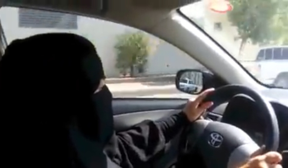 An image from a video uploaded by Saudi activists on YouTube on Oct. 26, 2013 allegedly shows a fully veiled woman driving in Riyadh during a planned nationwide day of defiance of the ban on women driving. Only a few Saudi women braved official threats of punishment and got behind the wheel in defiance of a ban on driving, but organisers say their campaign will continue. Photograph by: DSK , AFP/Getty Images