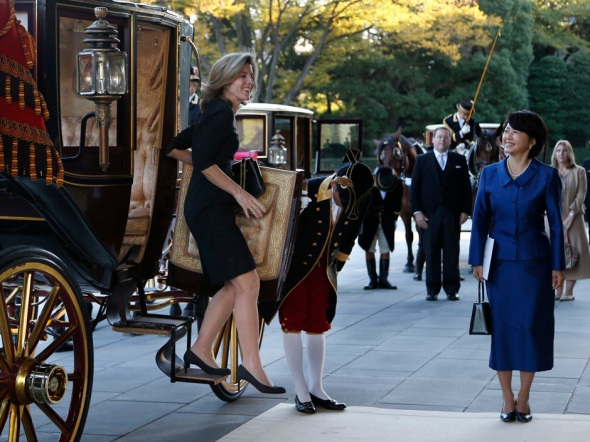 New U.S. Ambassador to Japan Caroline Kennedy smiles as she steps out from a horse-drawn imperial carriage upon her arrival at the Imperial Palace in Tokyo Tuesday, Nov. 19, 2013. Kennedy, who arrived in Tokyo Friday to replace her predecessor John V. Roos, presented credentials to Emperor Akihito in a formal court ceremony at the palace. (AP Photo/Koji Sasahara)