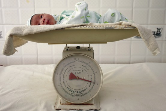 A newborn baby lies on a scale at a hospital in Suining, southwest China's Sichuan province. Reuters