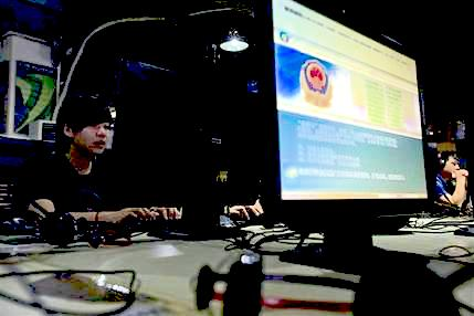 computer users sit near a display with a message from the Chinese police on the proper use of the internet at an internet cafe in Beijing, China. The Chinese government has declared victory in its recent campaign to clean up what it considers rumors, negativity and unruliness from online discourse, while critics say the moves have suppressed criticism of the government and ruling Communist Party. (AP Photo/Ng Han Guan, File)