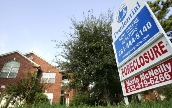 A sign showing a foreclosed home in Texas for sale in August 2006. (David J. Phillip/Associated Press.)
