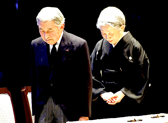 Japanese Emperor Akihito and Empress Michiko bow during a national memorial service for victims in Tokyo March 11, 2012, to mark the first anniversary of an earthquake and tsunami that killed thousands and set off a nuclear crisis.