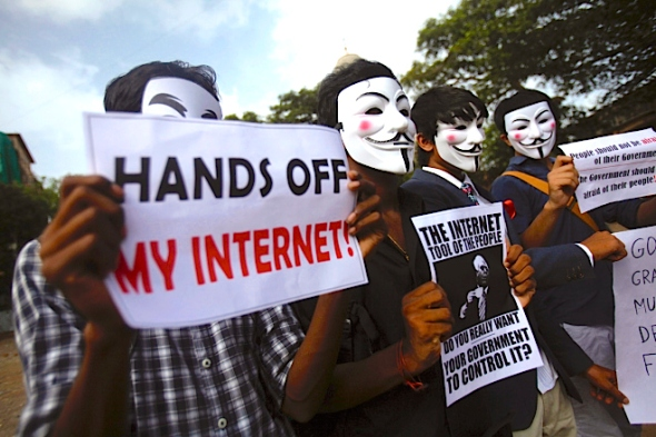 Protesters from the Anonymous India group of hackers wear Guy Fawkes masks as they protest against laws they say gives the government control over censorship of internet usage in Mumbai