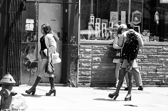 Ladies of the night: Prostitutes also populated the Bowery, plying their trade with johns who wandered in. Here, a man negotiates the price for a prostitute while two others walk past