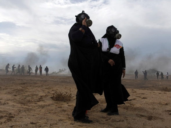 AP Photo/Tasnim, Hosein HeydarpourTwo female members of Iran's paramilitary Basij force, which is controlled by the Revolutionary Guard, attend a maneuver of preparation for possible attack on Iran's nuclear sites by the nuclear power plant in Bushehr, southern Iran.