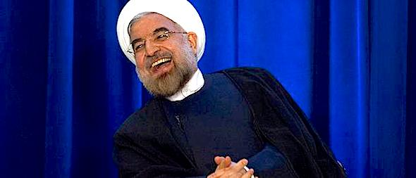 Iran's President Hassan Rouhani laughs as he speaks during an event hosted by the Council on Foreign Relations and the Asia Society in New York, September 26, 2013. REUTERS/Keith Bedford (