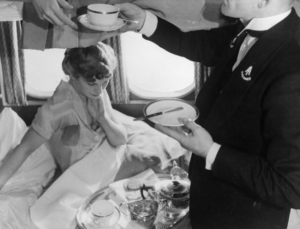 1936:  A passenger aboard the giant flying-boat, Canopus is served breakfast in her berth. The Canopus belonging to Imperial Airways is on the Alexandria-Athens service. It can cruise at 200mph and carries 16 passengers in night stages.  (Photo by General Photographic Agency/Getty Images)